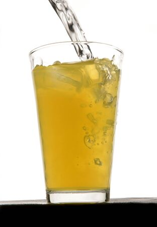 rehydration: Orange squash drink with ice in studio Stock Photo