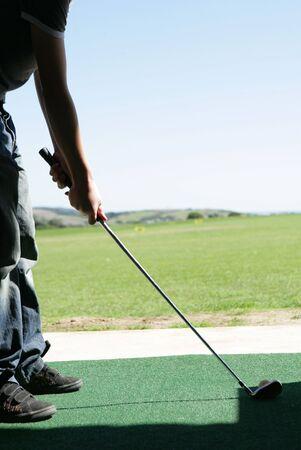 driving range: Teenage Golfer at driving range