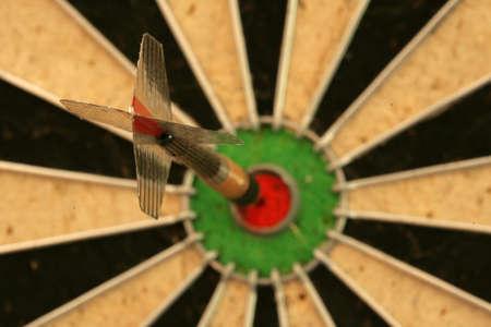Dart in bullseye on dartboard Stock Photo - 8072365