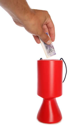Man donating twenty pounds to charity studio cutout photo