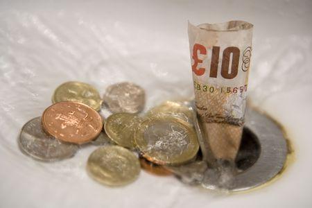 English money going down the drain