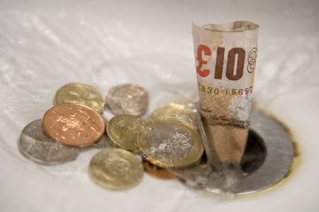 going down: English money going down the drain