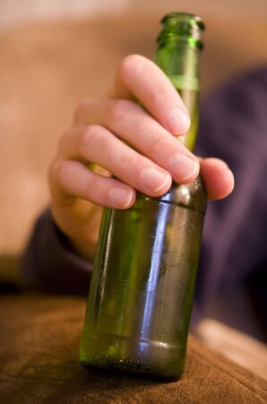 Man drinking bottle of beer portrait
