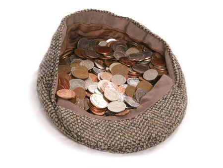 pound sterling: busking flat cap with british coins studio cutout