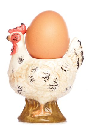 eggcup: Egg in hen egg-cup isolated studio cutout