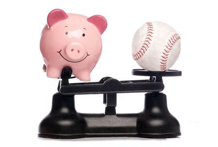 piggybank: Piggybank and baseball on scales studio cutout