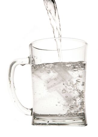 rehydration: Water in pint glass in studio Stock Photo