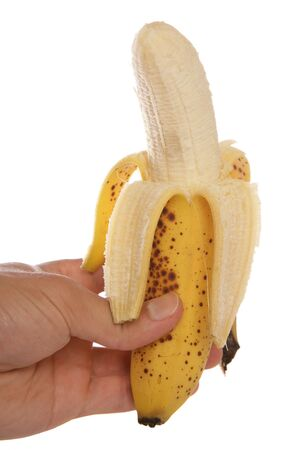 bannana: hand holding peeled bannana studio cutout Stock Photo