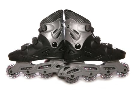Black roller blades studio cutout Stock Photo - 8072610