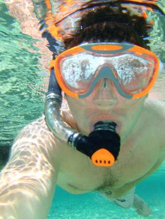 man snorkeling underwater  photo