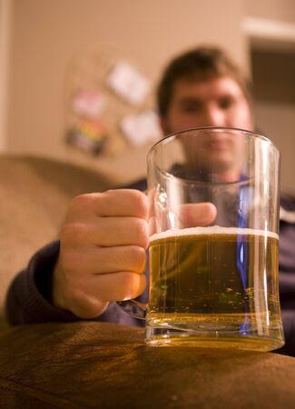 Man drinking pint of beer portrait