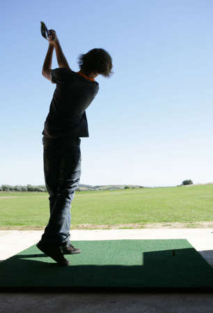 Teenage boy at driving range Stock Photo - 8072615