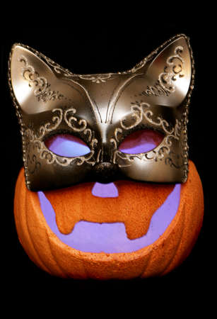 Halloween pumpkin wearing masquerade mask isolated studio cutout Stock Photo - 8072620