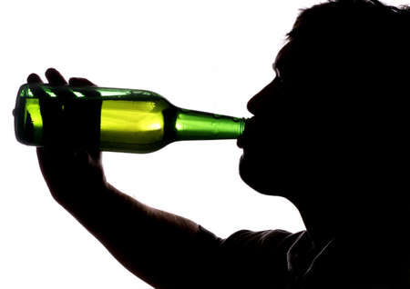 Man drinking bottle of beer silhouette photo