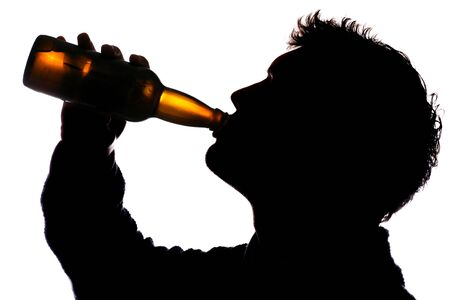 beer background: Man drinking bottle of cider silhouette