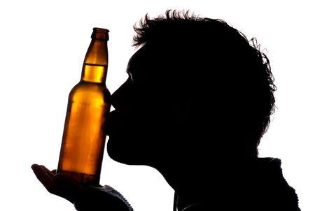 Man kissing bottle of cider silhouette Stock Photo