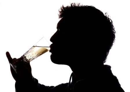 Man drinking glass of champagne silhouette photo