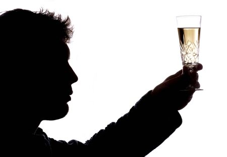 Man toasting with glass of champagne silhouette Stock Photo - 8072747
