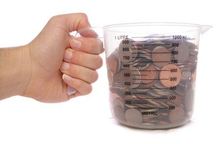 Hand holding measuring jug of money studio cutout Stock Photo - 8072748
