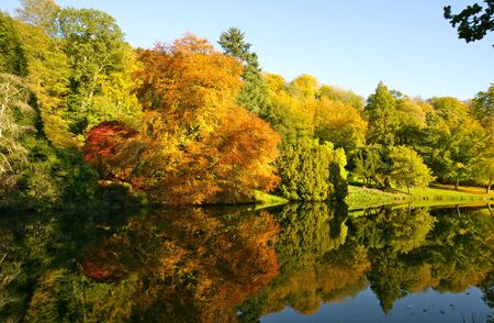 stourhead: Autumn trees and lake landscape