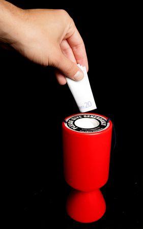 charity collection tin with twenty euros photo