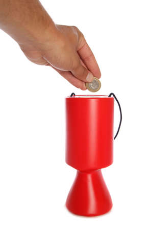 Man donating two pounds to charity studio cutout photo