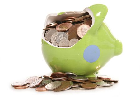 smashed: smashed piggy bank moneybox with British currency coins Stock Photo