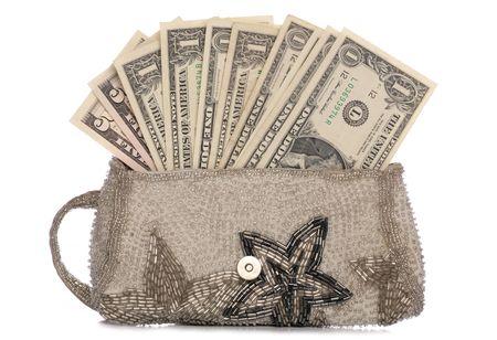 silver purse with american dollars studio cutout photo