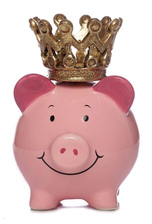 Piggybank with crown studio cutout photo