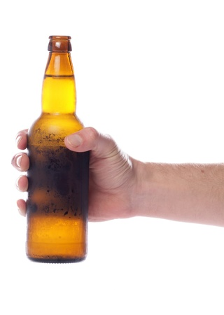 Hand holding beer bottle studio cutout photo