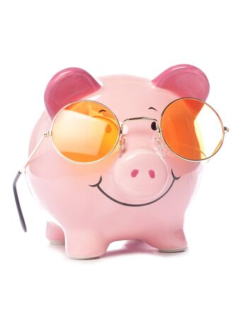 Piggy bank wearing retro sunglasses studio cutout photo