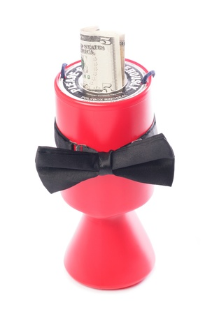 Black bow tie charity donation with five dollars studio cutout Stock Photo - 8905735