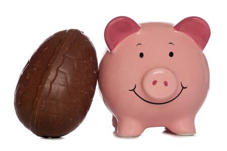 piggybank: piggybank with easter egg studio cutout Stock Photo