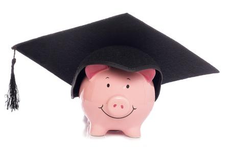 piggybank: Piggybank with mortar board hat studio cutout