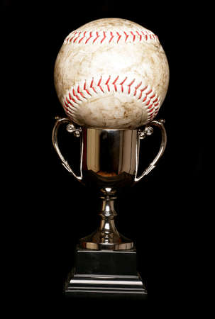 Trophy and softball isolated on black photo