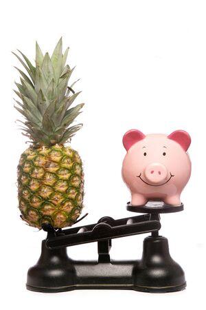 Balancing healthy eating and saving money studio cutout Stock Photo