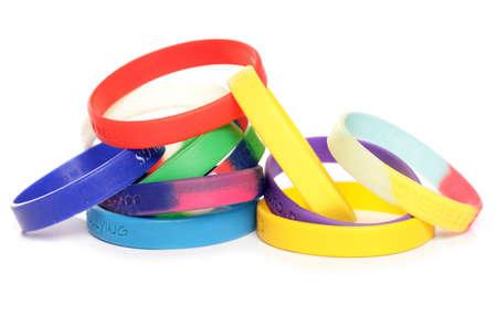 Various charity fundraising wristbands studio cutout Stock Photo