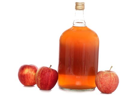 Bottle of cider with apples studio cutout photo