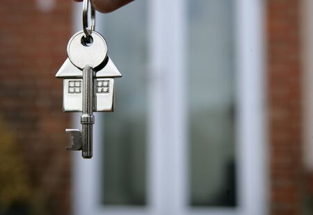 buying a house: House keys and keyring closeup