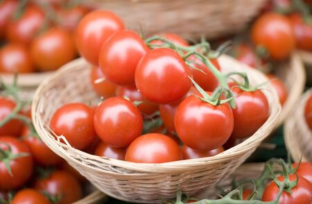 Bunch of cherry tomatoes on a market stool Stock Photo - 10673409