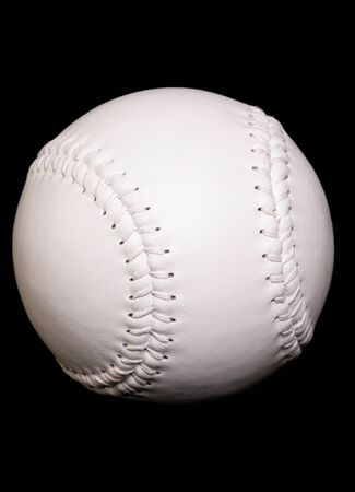 new white softball on black background Stock Photo - 10780098