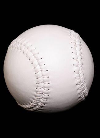 new white softball on black background Stock Photo - 10780098