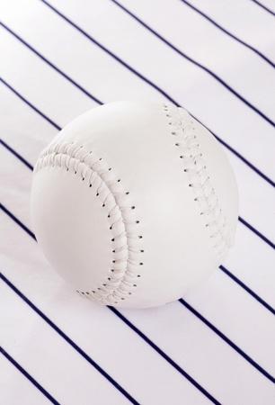 pinstripe: softball on pinstripe background in studio