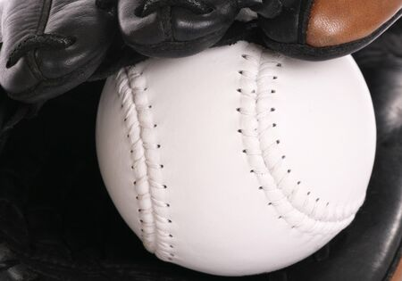 softball inside glove in a studio Stock Photo - 10815603