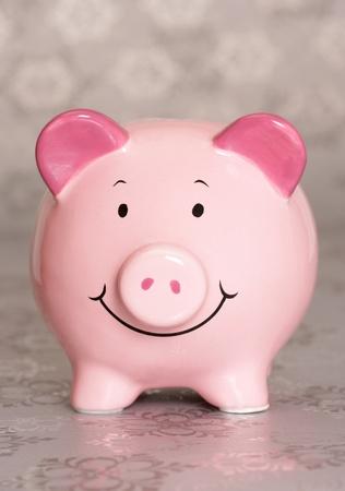 Piggybank on silver christmas paper photo