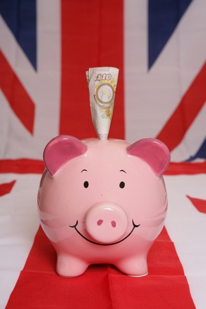 Saving ten pounds with piggybank on union jack photo
