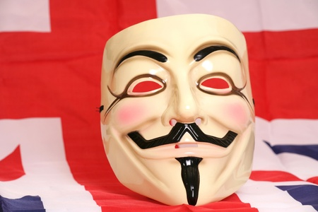 guy fawkes mask: guy fawkes mask on union jack flag