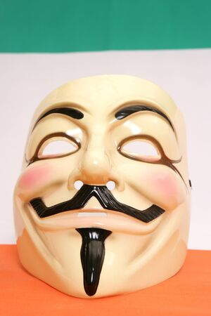 guy fawkes mask: Guy fawkes mask on irish flag Editorial