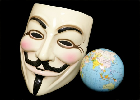 guy fawkes mask: Guy fawkes mask with world globe on black background