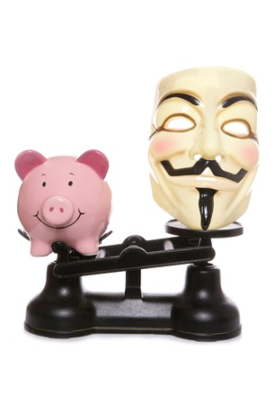 Guy fawkes mask with piggy bank on a white background